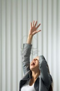 8455113-photo-of-unhappy-female-shouting-with-her-arm-raised-in-pray